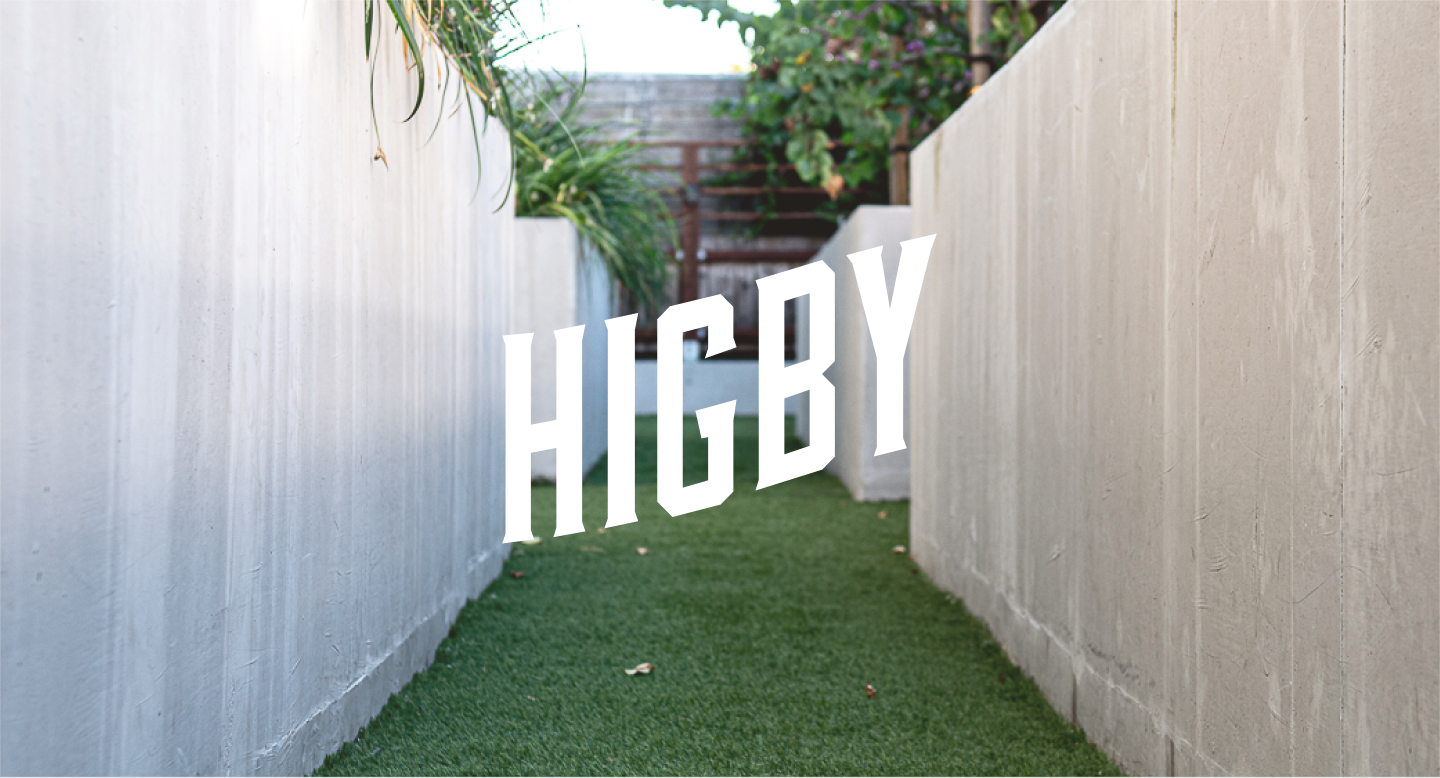 Higby Outdoor Green Space With Higby Logo